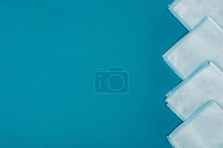 Photo for Top view of row of blue rags isolated on blue - Royalty Free Image