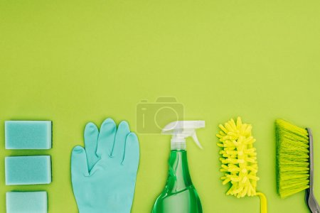 top view of rubber glove and spray bottle isolated on light green