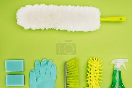 top view of dust brush and cleaning supplies isolated on light green