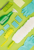 top view of cleaning supplies isolated on light green