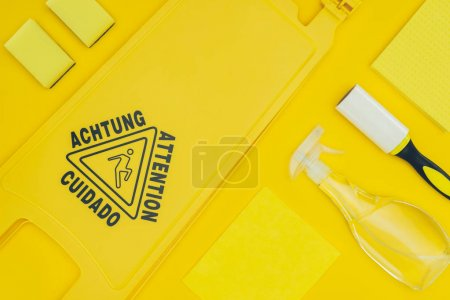 top view of wet floor sign isolated on yellow