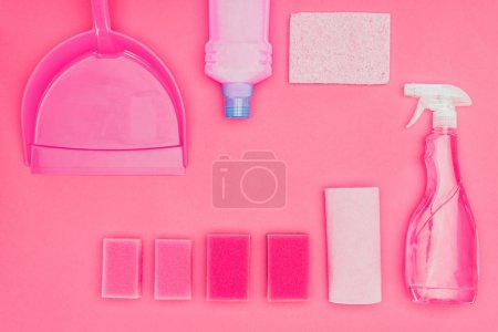 top view of washing sponges and cleaning fluids isolated on pink