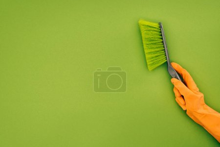 Photo for Cropped image of woman holding cleaning brush isolated on green - Royalty Free Image