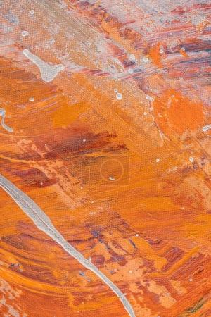 abstract orange texture with oil paint splatters