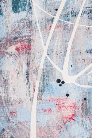 close up of white oil paint splatters on abstract background