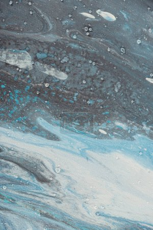 close up of art background with light blue and grey oil paint