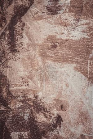 brown brush strokes on abstract artistic background