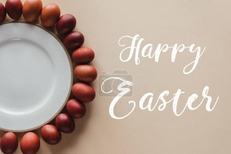 top view of painted easter eggs around plate with Happy Easter inscription