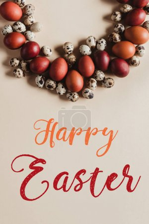 top view of circle frame made of quail and chicken easter eggs with Happy Easter lettering