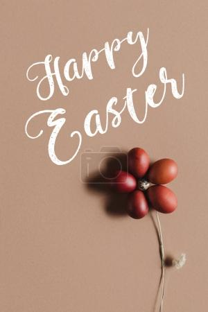 easter food composition with flower made of eggs on beige with Happy Easter inscription