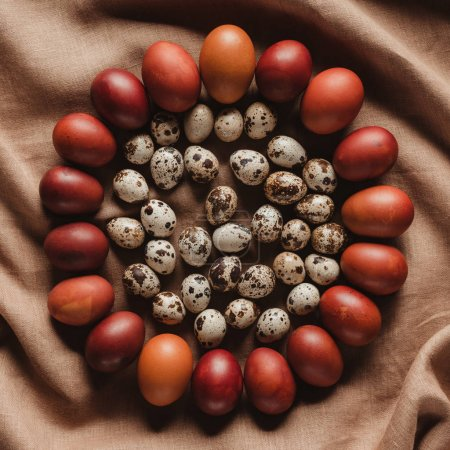 top view of easter quail eggs in circle of chicken eggs on linen tablecloth