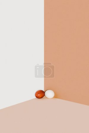 easter chicken eggs on beige and white minimalistic background