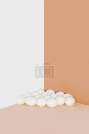 white chicken eggs on minimalistic background