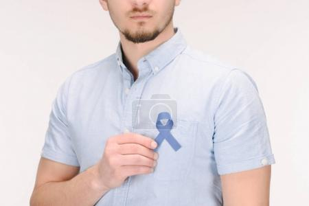 partial view of man with blue awareness ribbon isolated on white, colon cancer concept
