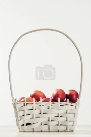 traditional painted chicken eggs in basket on grey, easter concept