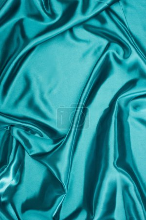 turquoise shiny wavy satin fabric background