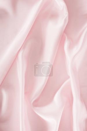 light pink shiny satin fabric background