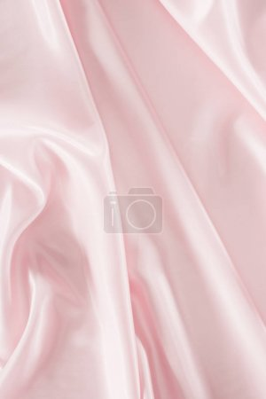 light pink shiny satin fabric background