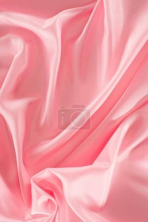 Photo pour Fond de tissu satin brillant rose - image libre de droit