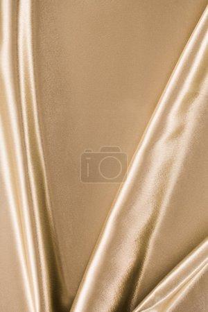 Photo pour Doré élégant fond de tissu satiné - image libre de droit