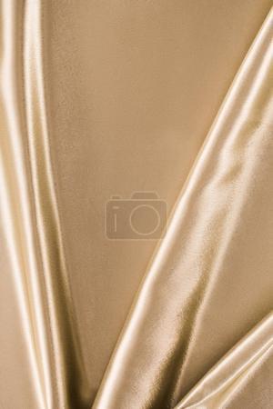 fond de tissu satin élégant doré
