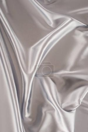 silver crumpled satin fabric background