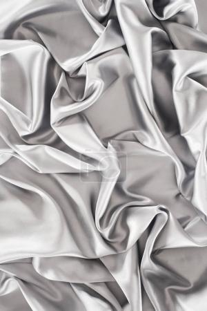 crumpled silver silk fabric background