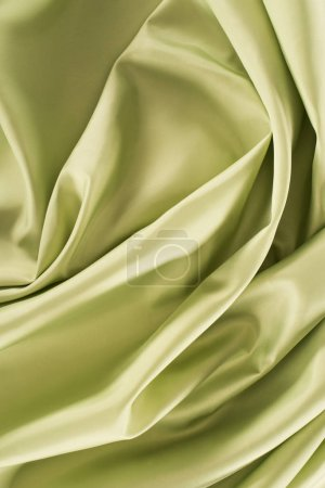 green crumpled shiny silk fabric background