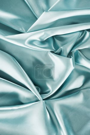 light turquoise crumpled shiny satin fabric background