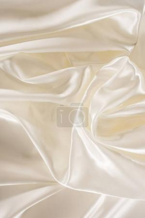 Photo for Ivory soft shiny silk fabric background - Royalty Free Image