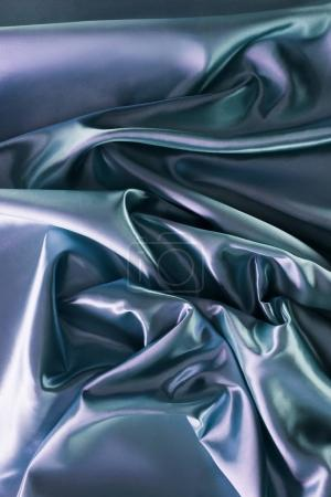 Photo for Silver and green shiny silk fabric background - Royalty Free Image
