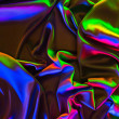 Colored crumpled shiny silk fabric background...