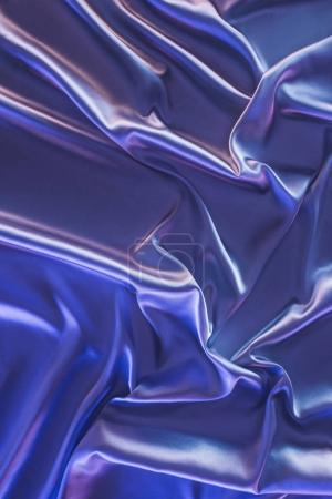violet crumpled shiny satin fabric background