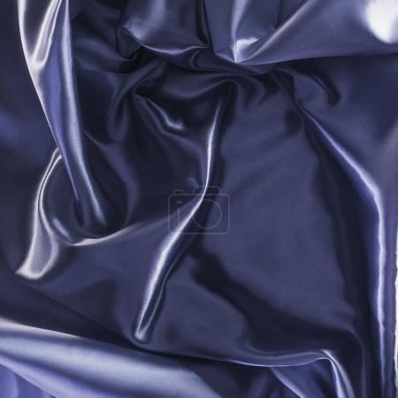Photo pour Fond de tissu de satin brillant violet foncé - image libre de droit