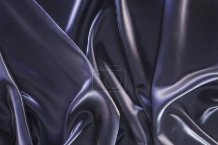 Photo for Dark violet shiny silk fabric background - Royalty Free Image