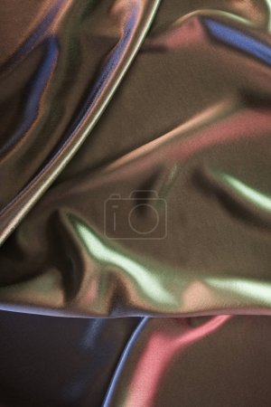 Green and pink shiny satin fabric background
