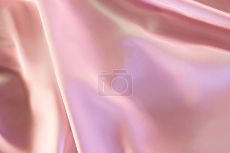 beige and pink shiny silky fabric background