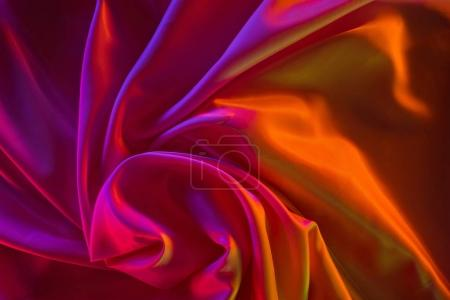 Photo for Pink and crimson shiny silk fabric background - Royalty Free Image