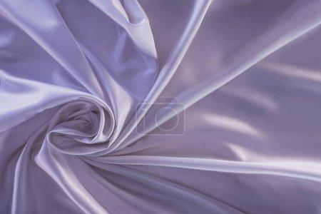 crumpled violet shiny silk fabric background
