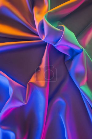 violet and green shiny silk fabric background