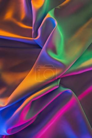 orange and green shiny silk fabric background