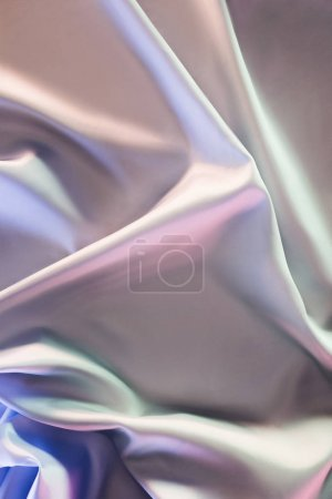 beige and violet shiny silk fabric background