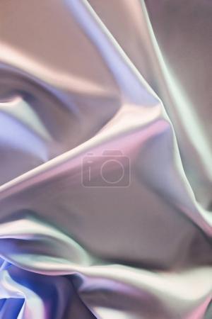 fond de tissu de soie brillant beige et violet