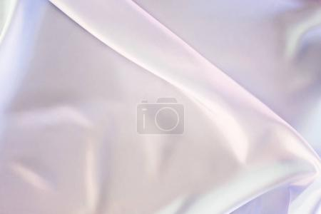 light beige and pink shiny satin fabric background