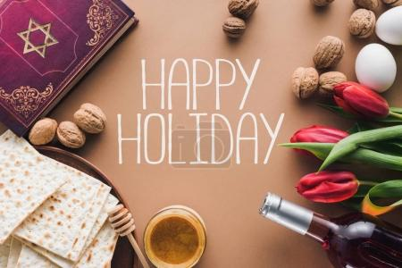 top view of traditional book with text in hebrew and happy holiday greeting