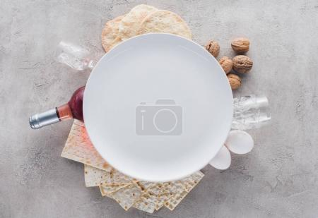 Photo for Top view of plate on matza and wine, Pesah celebration concept - Royalty Free Image