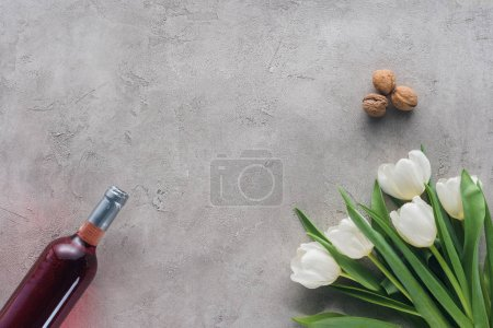 top view of wine and tulips on concrete table, jewish Passover holiday concept