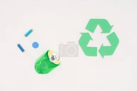 top view of various trash with recycle sign on white