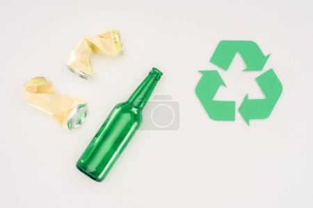 top view of beer cans and bottle with recycle sign on white