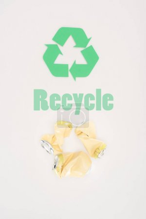 top view of metal beer cans with recycle sign on white